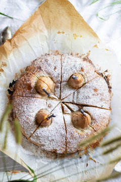 Flatlay / Table top view Pears in poppy seed cake on baking paper cut into pieces