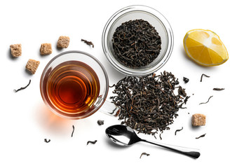 Black tea and accessories top view on white background