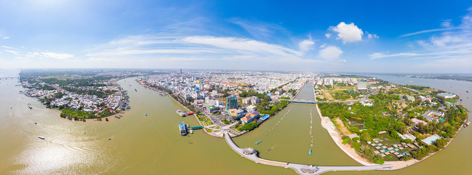 Aerial view Can Tho city skyline from above, Mekong river delta, South Vietnam. Famous tourism destination floating markets. Clear blue sky.