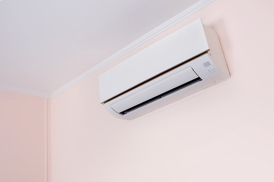 Wall mounted air conditioner in livingroom after cleaning and maintenance.