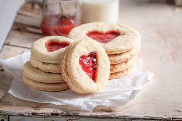 Tasty biscuits for valentine with red strawberries jam