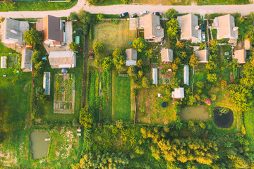 Aerial View Of Small Town Cityscape Skyline In Summer Day. Residential District, Houses And Garden...