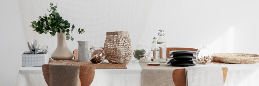 Rattan decoration and linen napkins on the table