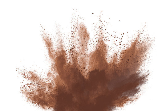 Brown color powder explosion isolated on white background. Colored cloud. Colorful dust explode. Paint Holi.