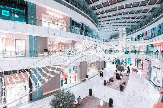 28 November 2019, UAE, Dubai: Interior of the biggest Dubai mall with various retail shops