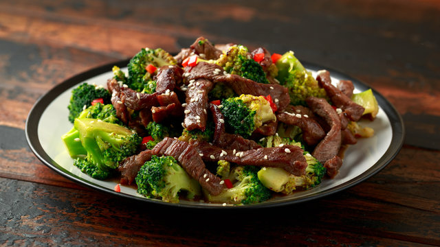Homemade Beef and Broccoli on wooden table