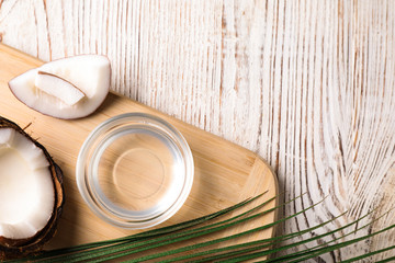 Coconut oil on white wooden table, flat lay