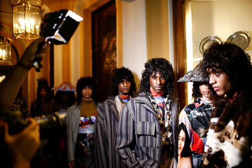 Models prepare backstage ahead of the Edward Crutchley catwalk show at London Fashion Week Mens Spring/Summer 2020 in London