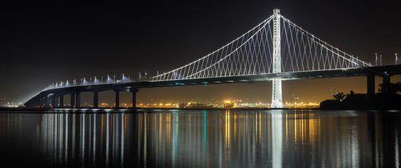 Eastern span of San-Francisco-Oakland Bay Bridge panoramic view at night. Shot from Treasure Island, San Francisco, California, USA. Fotomurales