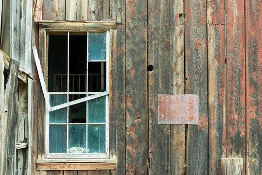 Broken Window on an Abandoned Building in Bayhorse Ghost Town, Idaho, USA