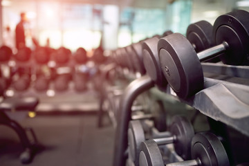 Papiers peints Nature Dumbbells in a gym, flare effect