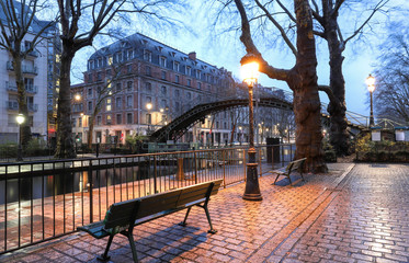 The park near Canal Saint-Martin at night .It is long canal in Paris, connecting the Canal de l'Ourcq to the river Seine.