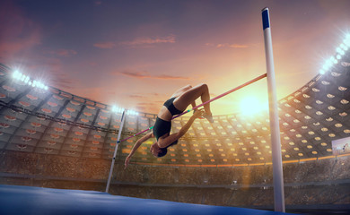 Obraz Athlete woman doing a high jump on sport championship. - fototapety do salonu