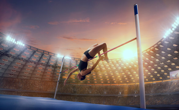 Athlete woman doing a high jump on sport championship.