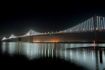 View of the Oakland Bridge With Moon Rising and Calm Skies Fotomurales