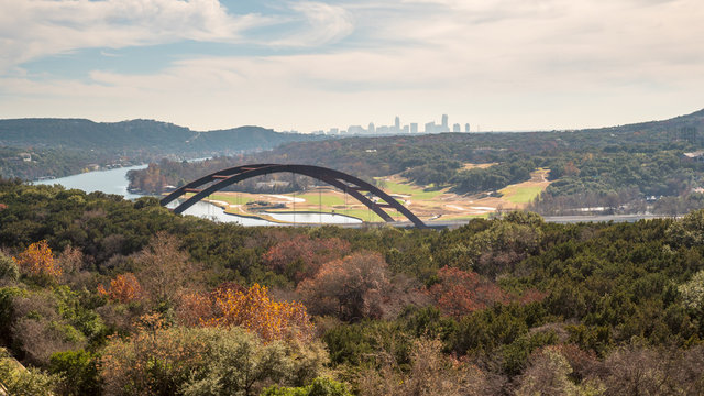 View of of Metal Bridge outside of Austin Texas, with Skyline in the Background