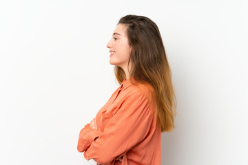 Young brunette girl over isolated white background in lateral position