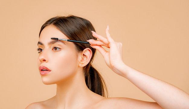 Womans eyebrows. Beauty. Beautiful girl with eyebrow brush. Girl with natural make up. Eyebrow correction.