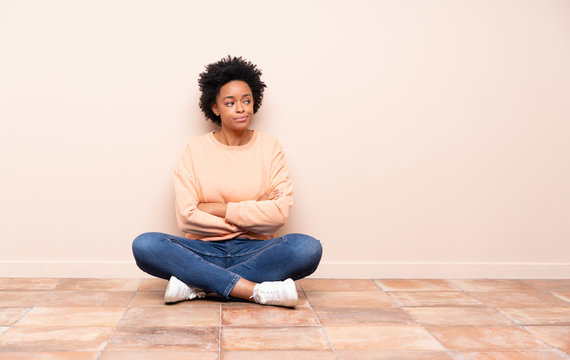 African american woman sitting on the floor portrait