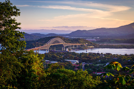 Container ship passing through Panama canal in scenic landscape