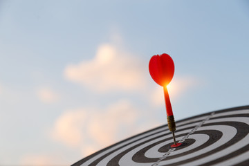 Red dart target arrow hitting on bullseye with,Target marketing and business success concept