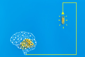 Great ideas concept with human brain, paperclip,thinking,creativity,light bulb on blue...