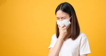 Asian women wear masks to protect disease on orange background.