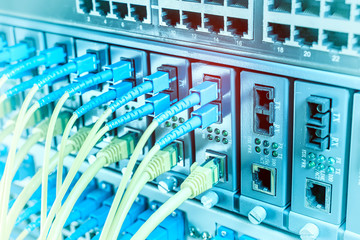 Autocollant pour porte Fleur Fiber Optic cables connected to an optic ports and Network cables connected to ethernet ports