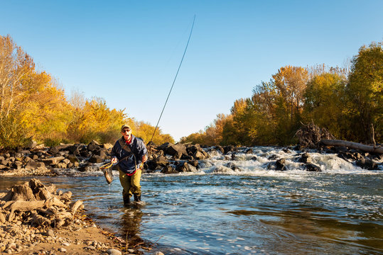 Fisherman shows excitement after catching a fish in the Boise River.