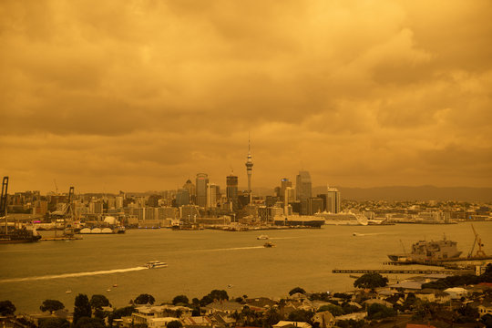 The sky over Auckland, New Zealand turns yellow and orange from smoke blown across the Tasman Sea from the Australian bush fires over 2000km away.