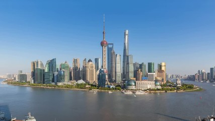 Wall Mural - time lapse of shanghai skyline in sunny afternoon, beautiful cityscape of pudong financial center and busy huangpu river, China