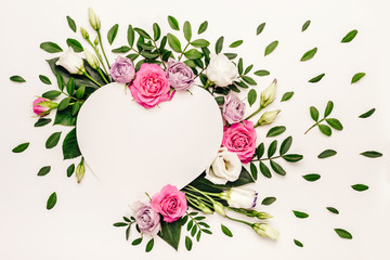Valentine's day romantic concept. Creative floral heart made of white and pink roses and green leaves