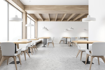 White loft cafe interior with square tables