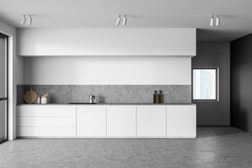 White and gray kitchen interior with countertops