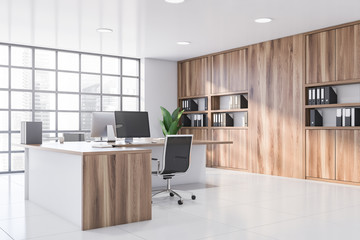 White CEO office corner with wooden table