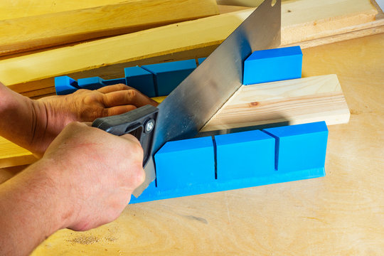 Miter box and hacksaw for sawing carpentry parts