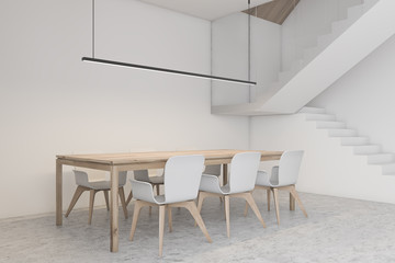 White dining room corner with stairs