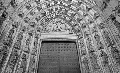 Wall Mural - SEVILLE, SPAIN - OCTOBER 28, 2014: The main west portal (Puerta de la Asuncion) of Cathedral de Santa Maria de la Sede by Pedro de Toledo, J. de Hoces, F.de Rosales for neo-gothic part.