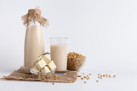 Soybean milk, tofu cheese and beans on white background
