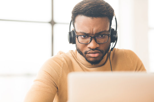 Portrait of concentrated african customer service agent