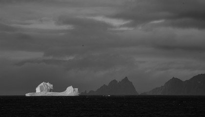 In de dag Antarctica Dramatic landscape of Antarctica with a huge iceberg slowly melting off the coast