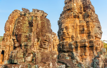 Wall Mural - Scenic view of towers with stone faces of Bayon temple