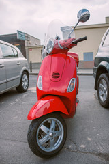 Türaufkleber Scooter Vintage red scooter is on the street.