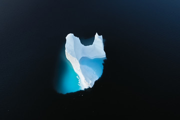 Fototapete - Aerial view of large glacier and iceberg