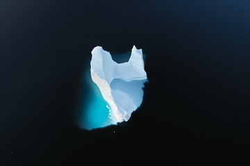 Wall Mural - Aerial view of large glacier and iceberg