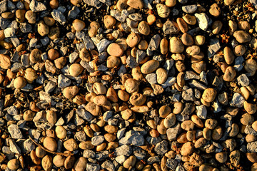Background texture of stone wall. abstract background with dry round reeble stones.