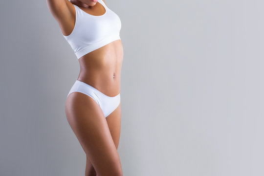 Cropped of black woman demonstrating her beautiful body