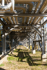 Industrial equipment. Pipeline overpass - bottom view. Metal structures at the factory.