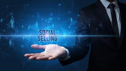 Elegant hand holding SOCIAL SELLING inscription, social networking concept
