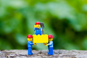 Orvieto, Italy - August 16th 2015: Couple of Lego Farmer  Planting Flowers in a garden. Lego is a popular line of construction toys manufactured by the Lego Group
